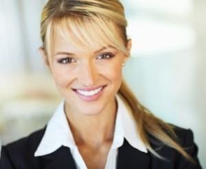 Closeup portrait of a cute young business woman smiling - Copyspace
